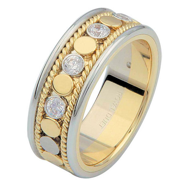 Item # 687630101D - 14 kt two-tone gold, 6.9 mm wide, comfort fit, diamond eternity ring. The band has a beautiful combination of white and yellow gold with diamonds set in the center. There are hand crafted ropes in the ring. The ring has about 0.28 ct tw round brilliant cut diamonds, that are VS1-2 in clarity and G-H in color.