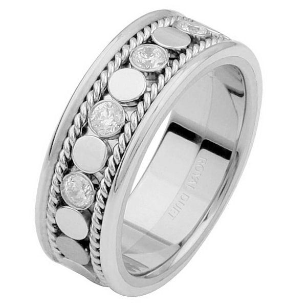 Item # 687631020DWE - 18 kt white gold, 6.9 mm wide, comfort fit, diamond eternity ring. The band has a beautiful design made with white gold and diamonds set down the center. There are hand crafted ropes in the ring. The ring has about 0.28 ct tw round brilliant cut diamonds, that are VS1-2 in clarity and G-H in color.
