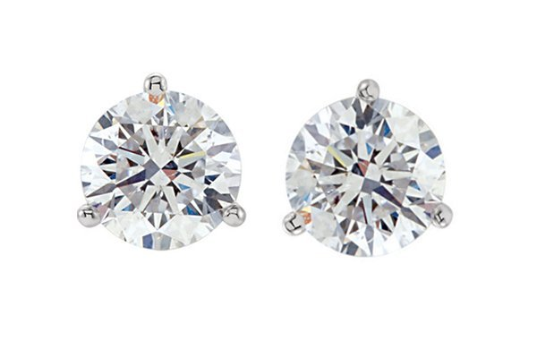 Item # 730753PP - Platinum 3-prongs, friction back diamond earrings. Diamonds together weigh approximately 0.75ct and are graded as VS iin clarity G-H in color.
