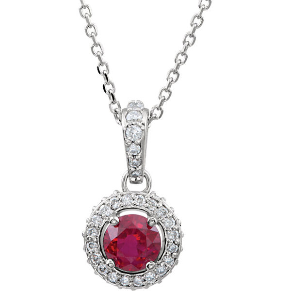 Item # 74279W - 14kt white gold, diamond and ruby halo neckace. There is one ruby in the center that measures about 4.6 mm in size with diamonds surrounding the stone. The diamonds are 0.25 ct tw, SI1-2 in clarity and G-H in color. The pendant hangs on an 18