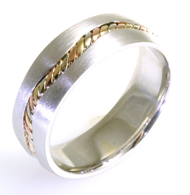 Item # A122261E - 18 kt tri-color hand made comfort fit Wedding Band 7.0 mm wide. There is a beautifully hand crafted yellow, rose, and white gold braiding inlayed in the center. The finish is matte. Different finishes may be selected or specified.