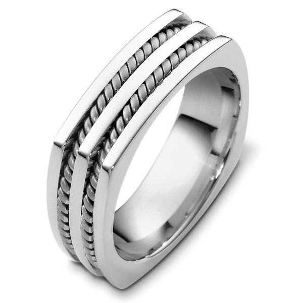 Item # A125581WE - 18K White gold 7.0 mm wide comfort fit wedding band. There are two hand made ropes inlayed in the band. The finish on the ring is polished. Different finishes may be selected or specified.