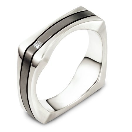 Item # A125881TE - 18 Kt White gold and titanium wedding band, 7.5 mm wide, comfort fit. The band holds 0.02 ct diamond that is VS in clarity and GH in color. The titanium has a matte finish and the outer edges have a polished finish. Different finishes may be selected or specified.