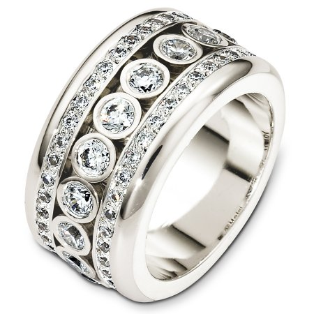 Item # A127161W - 14 Kt White gold and diamond wedding band, 11.5 mm wide, comfort fit band. The eternity band holds 2.33 ct tw diamonds, VS in clarity and G-H in color. The ring has 13 diamonds in the center. The center diamonds floating (moving) within the band. The finish is polished. Different finishes may be selected or specified.