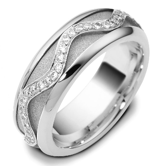 Item # A7769W - 14K white gold, 7.0mm wide, comfort fit diamond wedding band. the center part is rotating. Diamond total weight is 0.30ct in size 6.0. The diamonds are graded as VS in Clarity and G-H in color.