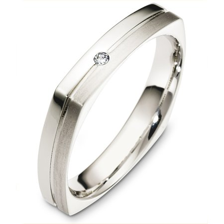 Item # B131751W - 14 Kt White gold and diamond wedding band, 4.0 mm wide, comfort fit band. This holds 0.05 ct diamond, VS1 in clarity and GH in color. Half the band is a matte finish and the other half is a polished finish. Different finishes may be selected or specified.