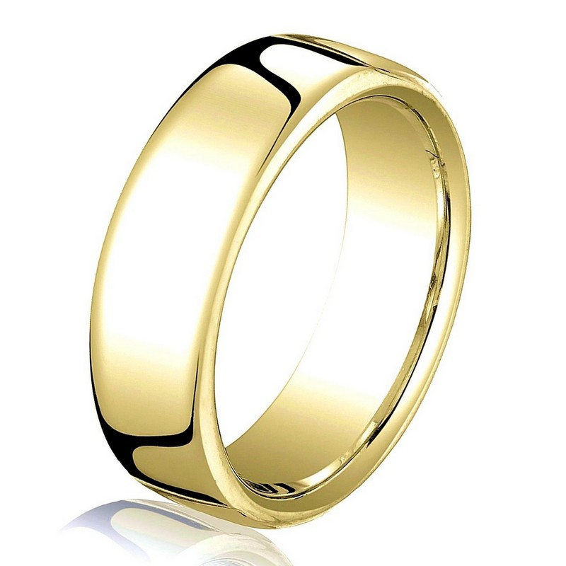 Item # B25833E - 18 kt yellow gold, plain, comfort fit European style 5.5 mm wide wedding band. The ring has a slight flat surface and comfort fit on the inside. It has a polished finish. Other finishes may be selected or specified.