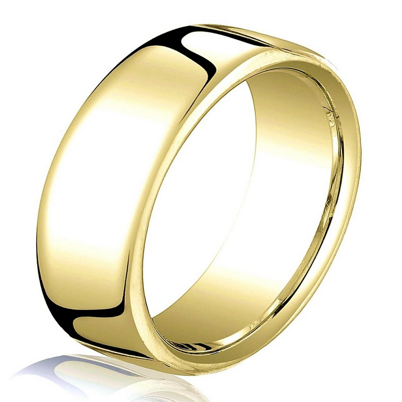 Item # B25853 - 14 kt yellow gold, plain,  comfort fit, 7.5 mm wide wedding band. The ring has a slight flat surface and comfort fit on the inside. It has a polished finish. Other finishes may be selected or specified.