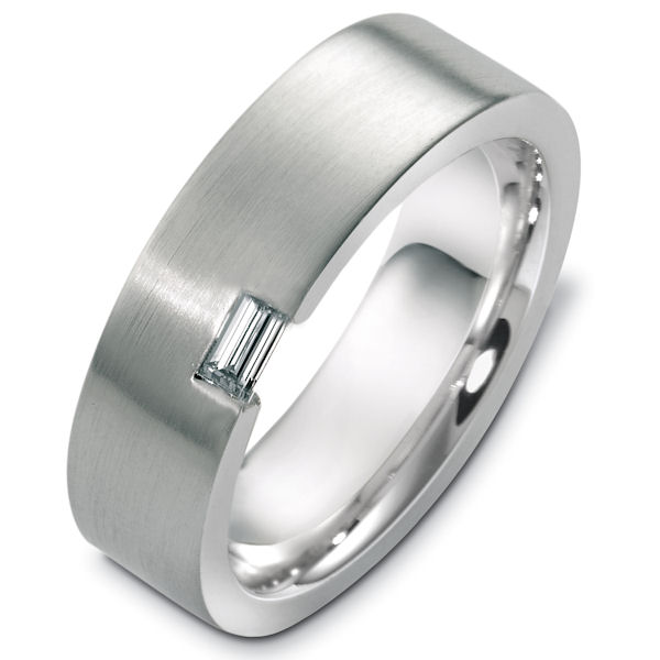Item # C124381W - 14kt White gold diamond, comfort fit, 7.0mm wide wedding band. There is one straight baguette cut diamond that is about 0.20ct, VS1-2 in clarity and G-H in color. The ring has a matte finish. Other finishes may be requested.