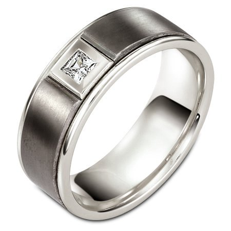 Item # C127521TE - Titanium and 18 Kt White gold diamond wedding band, 8.0 mm wide, comfort fit band. It holds one 0.16 ct diamond, VS in clarity and GH in color. The titanium portion is matte and the rest of the ring is polished. Different finishes may be selected or specified.