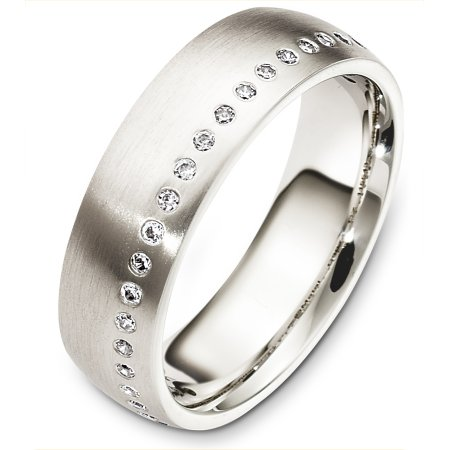 Item # C130741WE - 18 Kt White gold diamond eternity wedding band, 6.0 mm wide, comfort fit band.  It holds 23 diamonds of 0.23 ct tw, VS in clarity and GH in color. The finish is matte. Other finishes may be selected or specified.