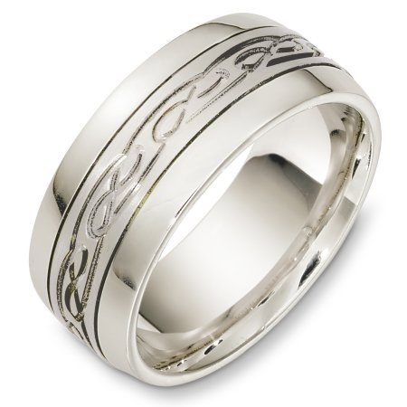 Item # C131331WE - 18 Kt White gold wedding band, 9.0 mm wide, comfort fit wedding band. The center has a carved design with a matte finish. The outer edges are polished. Different finishes may be selected or specified.