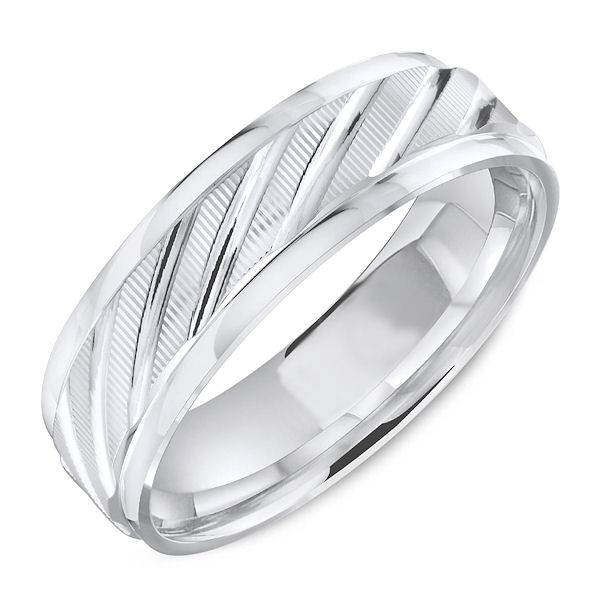 Item # C13727W - 14kt white gold, carved, comfort fit wedding ring. The ring is about 6 mm wide and 1.7 mm thick. The edges are polished with the center being carved. Different finishes are available. Please select the type of finish.