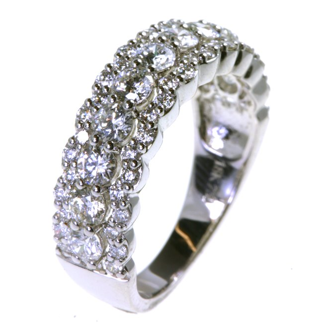 Item # DS8809WE - One platinum diamond anniversary band holds 57 round brilliant cut diamonds with total weigh of 1.47ct. The diamonds are graded as VS in clarity G-H in color.