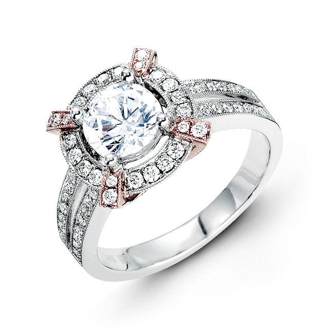 Item # E31946 - 14kt rose & white gold, halo, vintage diamond engagement ring. There are about 72 round brilliant cut diamonds set in the ring. The diamonds are about 0.54 ct tw, VS1-2 in clarity and G-H in color. Center stone is sold separately and in different sizes. Pictured is a 1.0 carat diamond.
