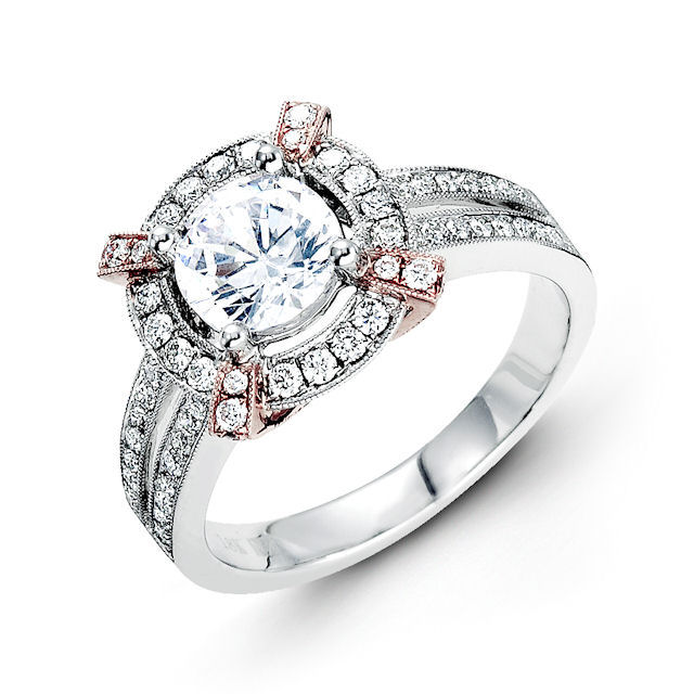Item # E31946E - 18kt rose & white gold, halo, vintage diamond engagement ring. There are about 72 round brilliant cut diamonds set in the ring. The diamonds are about 0.54 ct tw, VS1-2 in clarity and G-H in color. Center stone is sold separately and in different sizes. Pictured is a 1.0 carat diamond.