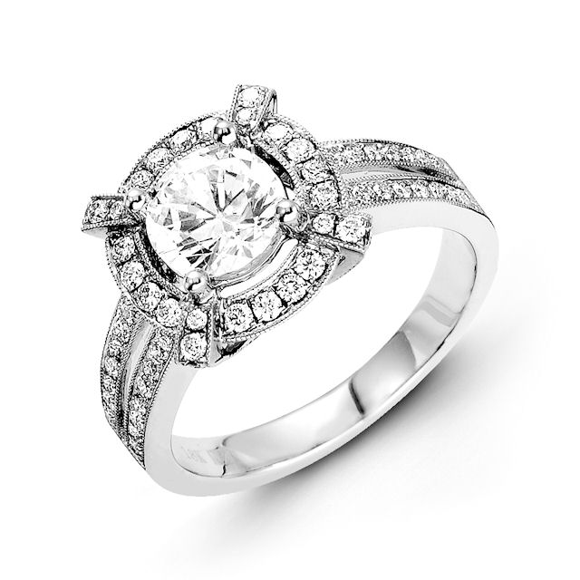 Item # E31946W - 14kt white gold, halo, vintage diamond engagement ring. There are about 72 round brilliant cut diamonds set in the ring. The diamonds are about 0.54 ct tw, VS1-2 in clarity and G-H in color. Center stone is sold separately and in different sizes. Pictured is a 1.0 carat diamond.