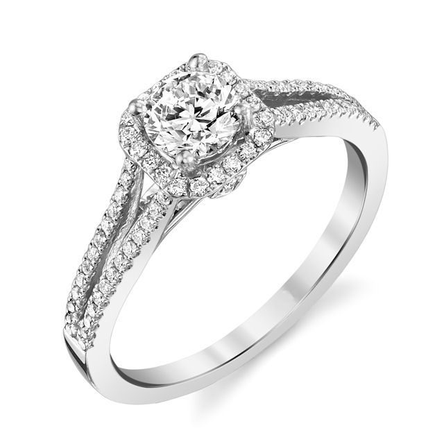 Item # E32144WE - 18kt white gold, halo, diamond engagement ring. There are about 74 round brilliant cut diamonds set in the ring. The diamonds are about 0.25 ct tw, VS1-2 in clarity and G-H in color. Center stone is sold separately and in different sizes. Pictured is a 0.75 carat round diamond
