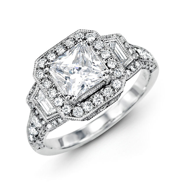 Item # E32209W - 14kt white gold, vintage, princess cut, diamond halo engagement ring. There are 88 round brilliant & baguette cut diamonds set around the center stone and down the side. The rounds diamonds are about 0.68 ct tw and the baguette cut diamonds are about 0.15 ct tw; VS1-2 in clarity and G-H in color. Center stone is sold separately and in different sizes. Pictured is a 1.0 carat princess cut diamond.