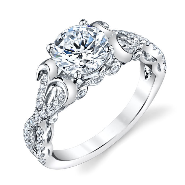 Item # E32526WE - 18kt white gold, sculptural, diamond engagement ring. There are about 50 round brilliant cut diamonds set in the ring. The diamonds are about 0.33 ct tw, VS1-2 in clarity and G-H in color. Center stone is sold separately and in different sizes. Pictured is a 1.25 carat diamond.
