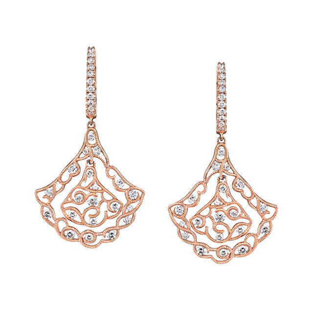 Item # E32559R - 14kt rose gold, vintage, diamond dangle earrings. There are 62 round brilliant cut diamonds set in the earrings. The diamonds are 1.17 ct tw, VS1-2 in clarity and G-H in color.