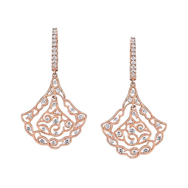 Item # E32559RE - 18kt rose gold, vintage, diamond dangle earrings. There are 62 round brilliant cut diamonds set in the earrings. The diamonds are 1.17 ct tw, VS1-2 in clarity and G-H in color.