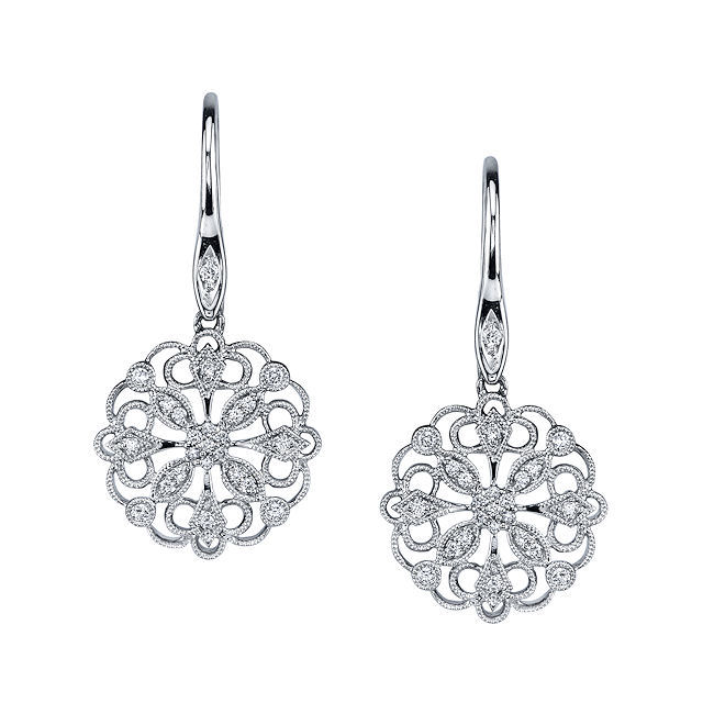 Item # E32589WE - 18kt white gold, circular, vintage, diamond dangle earrings. There are about 48 round brilliant cut diamonds set in the earrings. The diamonds are about 0.23 ct tw, VS1-2 in clarity and G-H in color.