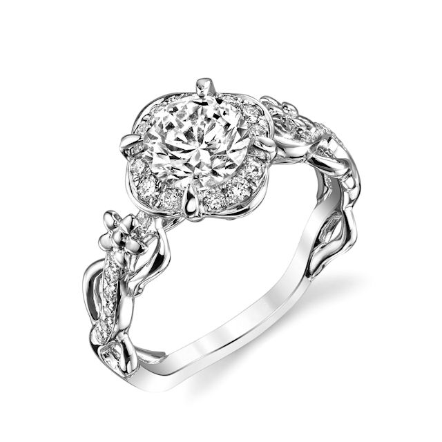 Item # E32741W - 14kt white gold, floral design, diamond halo engagement ring. There are 34 round brilliant cut diamonds set in around the center stone and the sides of the ring. The diamonds are about 0.26 carats total weight, VS1-2 in clarity and G-H in color. Center stone is sold separately and in other sizes. Pictured here is about a 1.0 carat diamond.