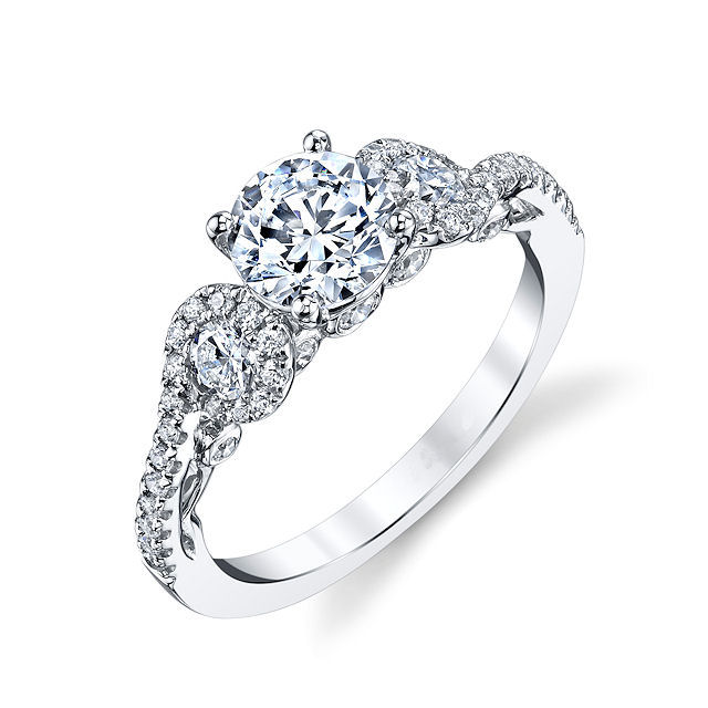 Item # E32921WE - 18kt white gold, diamond, sculptural engagement ring. There are about 46 round brilliant cut diamonds set in the ring. The diamonds are about 0.63 ct tw, VS1-2 in clarity and G-H in color. Center stone is sold separately and in different sizes. Picutred is a 1.0 carat diamond.