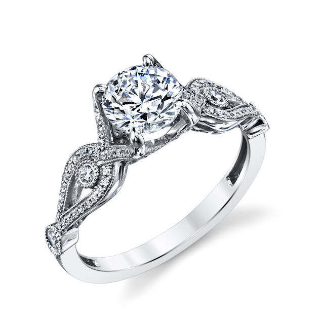Item # E33038WE - 18kt white gold, sculptural, diamond engagement ring. There are about 75 round brilliant cut diamonds set in the ring. The diamonds are about 0.21 ct tw, VS1-2 in clarity and G-H in color. Center stone is sold separately and for any size. Pictured is a 1.0 carat diamond.