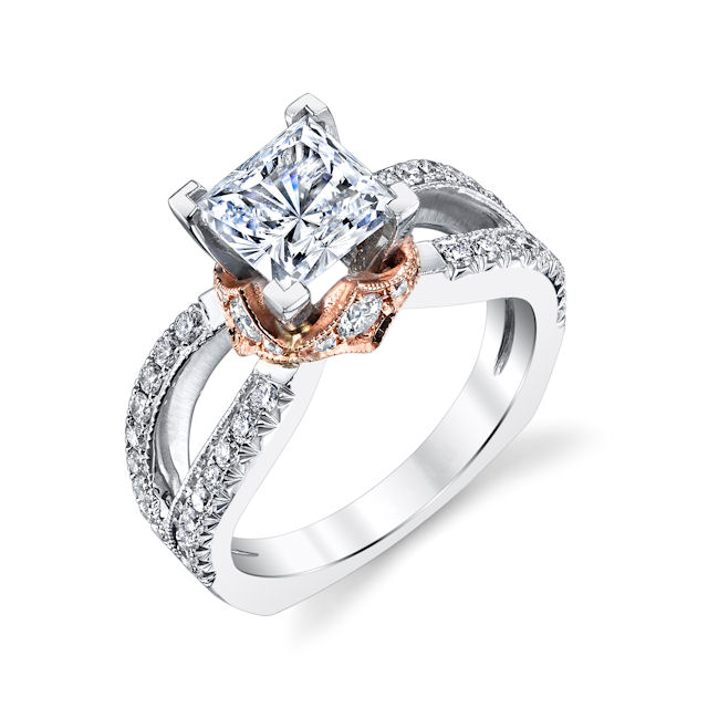 Item # E7044 - 14kt rose & white gold, diamond engagement ring. There are about 48 round brilliant cut diamonds set in the ring and around the center stone. The diamonds are about 0.70 ct tw, VS1-2 in clarity and G-H in color. Center stone is sold separately and in different sizes. Pictured is a 1.0 carat diamond.