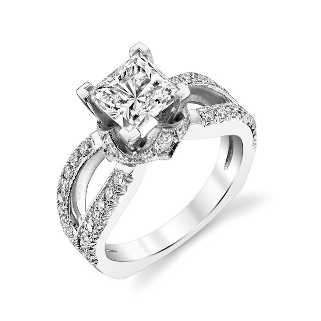 Item # E7044WE - 18kt white gold, diamond engagement ring. There are about 48 round brilliant cut diamonds set in the ring and around the center stone. The diamonds are about 0.70 ct tw, VS1-2 in clarity and G-H in color. Center stone is sold separately and in different sizes. Pictured is a 1.0 carat diamond.
