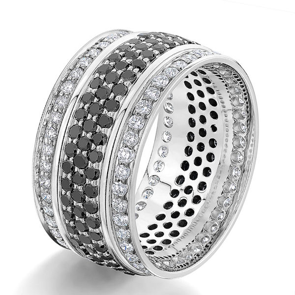 Item # G106864W - 14kt white gold, black & white diamond, comfort fit eternity ring. There are about 129 black round brilliant cut diamonds set in the center and about 86 round brilliant cut white diamonds set on the sides. The diamonds are about 2.15 ct tw, VS1-2 in clarity and G-H in color. Diamond count and weight may vary depending on the size. These specifications are for a size 6 ring. The ring is 10.0 mm wide.