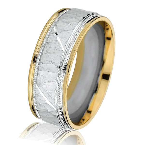 Item # G14658E - 18kt two-tone gold, hammered with milgrain, comfort fit, 8.0 mm wide wedding band. The center is in white gold with a hammered brushed finish. There are milgrains next to the white gold. The edges are made in yellow gold with a polished finish. Other finishes may be selected or specified. The ring is 8.0 mm wide.