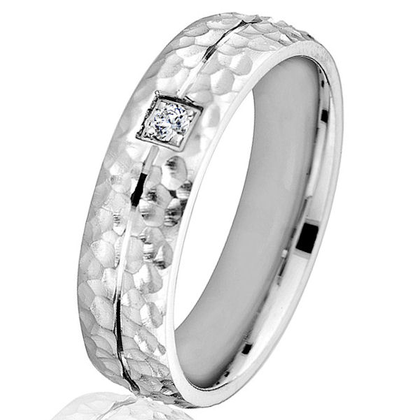 Item # G66764WE - 18kt white gold, hammered, diamond, comfort fit wedding ring. There is one round brilliant cut diamond set in the center of the ring. The diamond is 0.05 carats, VS1-2 in clarity and G-H in color. The ring is 6.0 mm wide with a hammered finish in the center and polished finish on the outer edges.