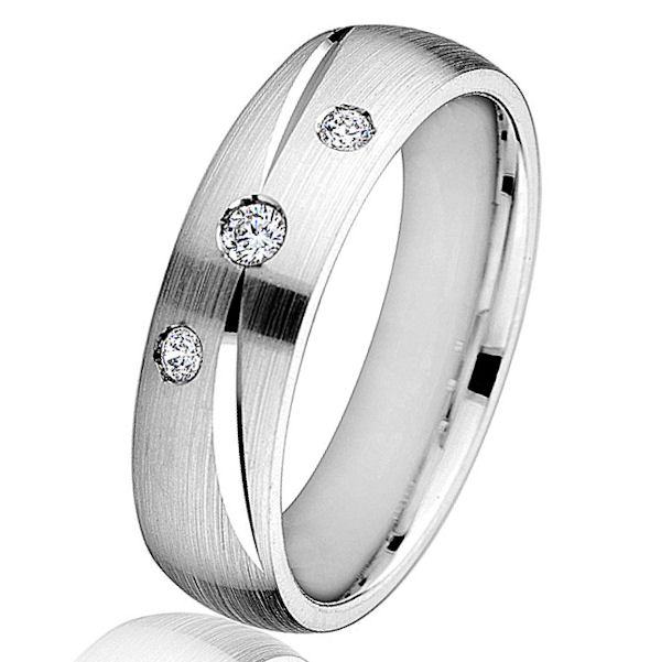 Item # G66766W - 14kt white gold, diamond, comfort fit, wedding ring. There are 3 round brilliant cut diamonds set in the ring. The diamonds are 0.11 ct tw, VS1-2 in clarity and G-H in color. The ring is 6.0 mm wide with a mix of brush and polish finish. Other finishes may be selected or specified.