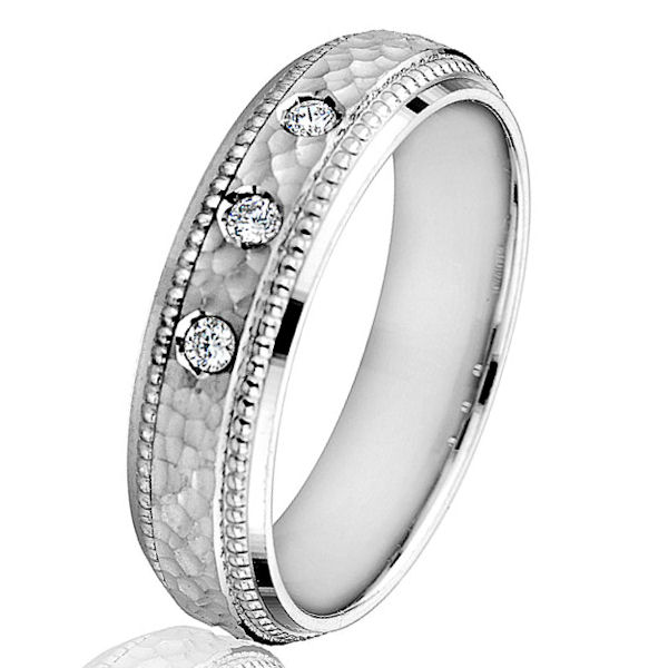 Item # G66767W - 14kt white gold, hammered, diamond, comfort fit wedding ring. There are 3 round brilliant cut diamonds set in the ring. The diamonds are 0.09 ct tw, VS1-2 in clarity and G-H in color. The ring is 6.0 mm wide with a hammered finish in the center.