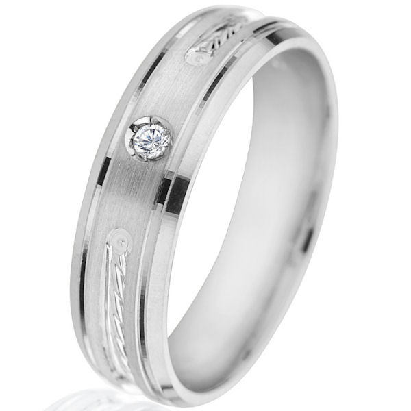 Item # G66940WE - 18kt white gold, diamond, comfort fit wedding ring. There is one round brilliant cut diamond set in the ring. The diamond is 0.03 ct tw, VS1-2 in clarity and G-H in color. The ring is 6.0 mm wide with a mix of polished and brush finish. Other finishes may be selected or specified.