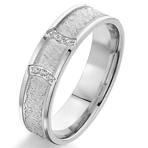 Item # G66970W - 14kt white gold, contemporary, diamond comfort fit wedding ring. There are 6 round brilliant cut diamonds set in the ring. The diamonds are 0.06 ct tw, VS1-2 in clarity and G-H in color. The ring is 6.0 mm wide with a heavy carved finish in the center.