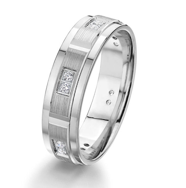 Item # G67202W - 14kt white gold, diamond, comfort fit wedding band. There are 12 round brilliant cut diamonds set in the ring. The diamonds are about 0.12 ct tw, VS1-2 in clarity and G-H in color. The center of the ring has a brushed finish with the edges being polished. Other finishes may be selected or specified. The ring is 6.0 mm wide.