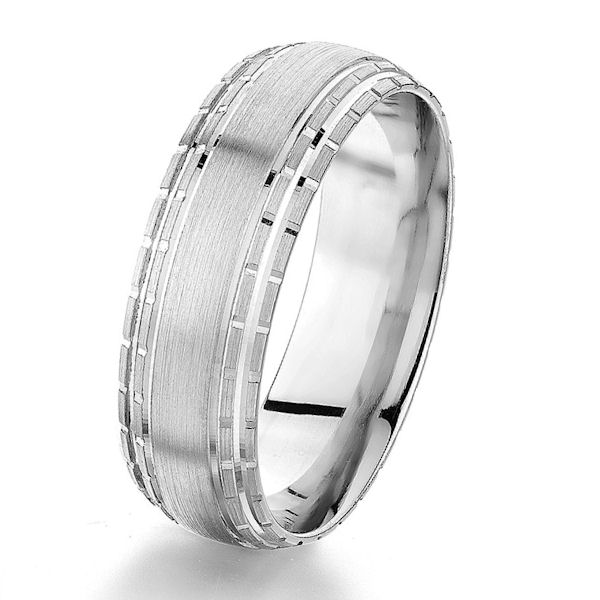 Item # G76857WE - 18kt white gold, 7.0 mm, carved, comfort fit wedding ring. The edges have a carved pattern around the whole ring. The ring is 7.0 mm wide. Center of the ring is a brushed finish. Other finishes may be selected or specified.