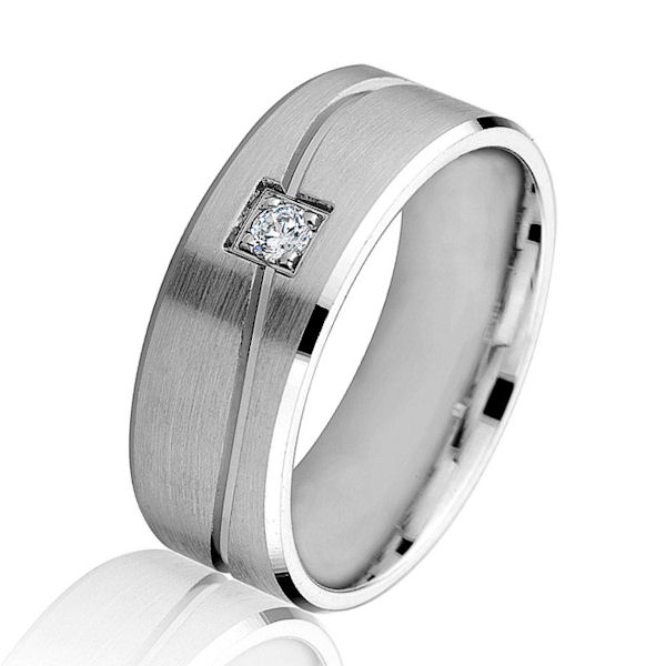 Item # G86854W - 14kt white gold, diamond, carved, comfort fit wedding ring. There is one round brilliant cut diamond set in the center. The diamond is 0.07 carats, VS1-2 in clarity and G-H in color. The ring is 8.0 mm wide with a brush finish in the center. Other finishes may be selected or specified.