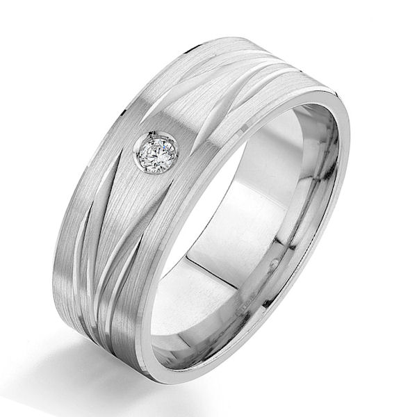 Item # G87003W - 14kt white gold, carved, diamond, comfort fit wedding ring. There is one round brilliant cut diamond set in the ring. The diamond is 0.05 carats, VS1-2 in clarity and G-H in color. The ring is 8.0 mm wide with a brush finish. Other finishes may be selected or specified.