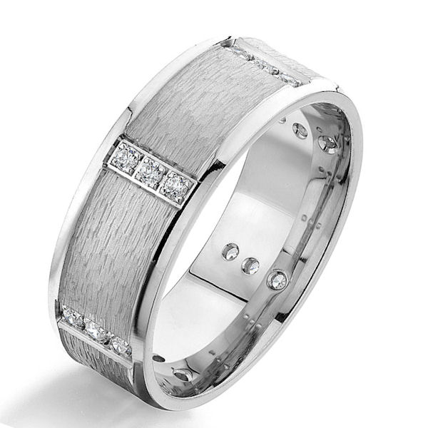 Item # G87006W - 14kt white gold, diamond, comfort fit wedding ring. There are 18 round brilliant cut diamonds set around the whole ring. The diamonds are 0.18 carats total weight, VS1-2 in clarity and G-H in color. The ring is 8.0 mm wide and has a rough finish in the center with the edges polished.