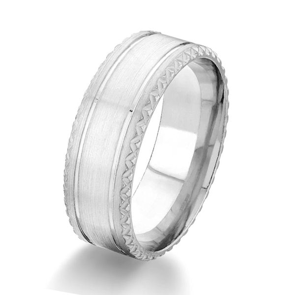 Item # G87069WE - 18kt white gold, 8.0 mm wide, comfort fit wedding ring. The ring has a brushed finish with a design on the edges. Other finishes may be selected or specified. The ring is 8.0 mm wide.