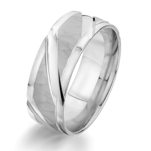 Item # G87155WE - 18kt white gold, 8.0 mm wide, carved, comfort fit wedding ring. The ring has a mix of hammered brush finish and polished finish. The ring is 8.0 mm wide.