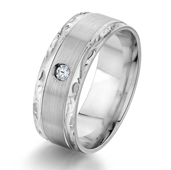 Item # G87190W - 14kt white gold, carved, 8.0 mm wide, diamond comfort fit wedding ring. There is one round brilliant cut diamond set in the ring. The diamond is about 0.05 carats, VS1-2 in clarity and G-H in color. The center of the ring is a brushed finish and the edges have a polished design finish. The ring is 8.0 mm wide.
