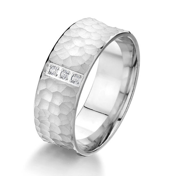 Item # G87197WE - 18kt white gold, hammered brush, diamond comfort fit wedding ring. There are 3 round brilliant cut diamonds set in the ring. The diamonds are about 0.06 ct tw, VS1-2 in clarity and G-H in color. The center of the ring is a hammered brush finish with the edges being polished. Other finishes may be selected or specified. The ring is 8.0 mm wide.