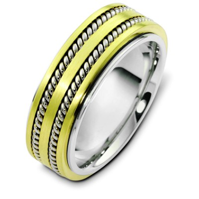 Item # H125571PE - 18K gold and platinum, 8.0 mm wide, comfort fit, wedding band. The wedding band is approximately 2.5mm thick rotating center can be made not to spin. There are two hand made ropes inlayed in the center of the ring. The finish on the ring is polished. Other finishes may be selected or specified.
