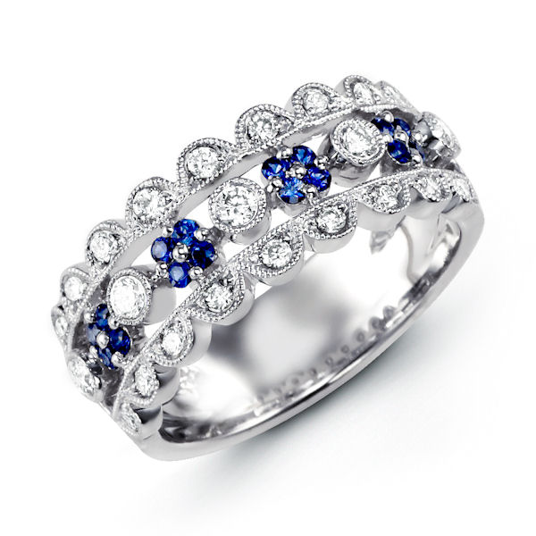 Item # M31759WE - 18kt white gold, diamond & sapphire, anniversary ring. There are a total of 84 round stones set in the ring. The diamonds are about 0.38 ct tw, VS1-2 in clarity and G-H in color. The genuine blue sapphires are about 0.21 ct tw.